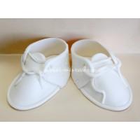 Bottines blanches de bébé en fondant